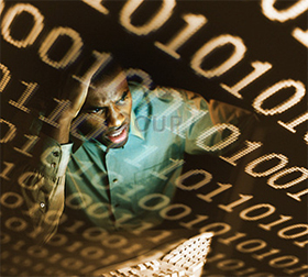 Confused man looking at code