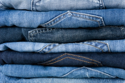 Stack of different denim jeans