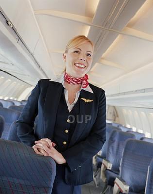 Female flight attendant smiling