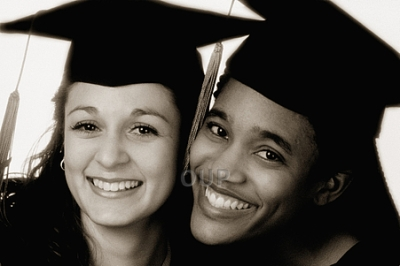 Two female students in graduation robes
