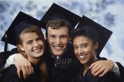 Three graduate students smiling