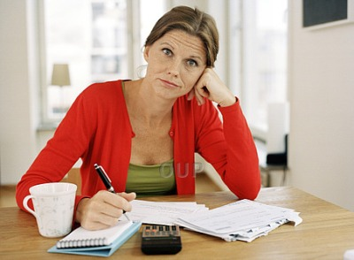 Woman with notepad looking confused