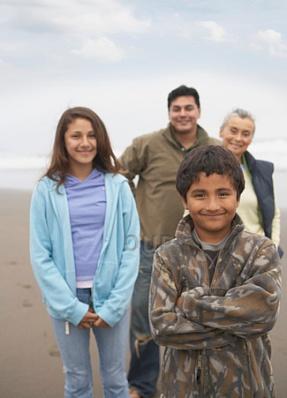 Multi-generation Latin American family on the beach