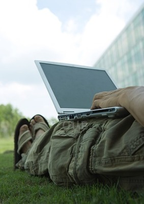 Laptop on legs on the grass