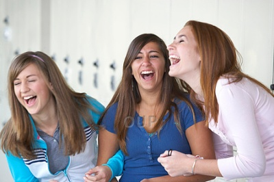 Three school girls laughing
