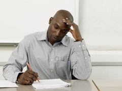 Man struggling while writing