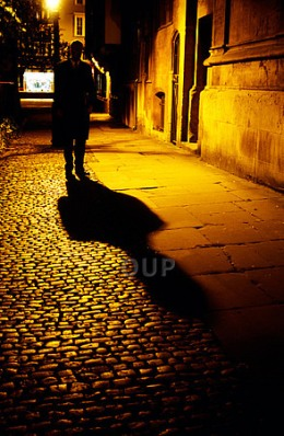 Shady figure walking the streets at night