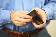 Man opening wallet