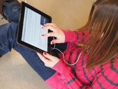 Student with iPad