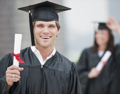 Male graduate student smiling