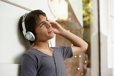 Teen boy wearing headphones