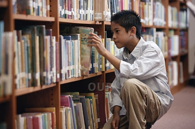 Young boy in library