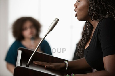 Young woman public speaking