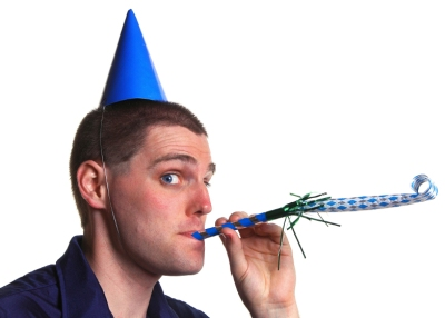 Man with a party hat and whistle