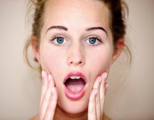 Woman massaging her facial muscles