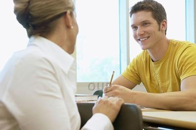 Professor speaking to student