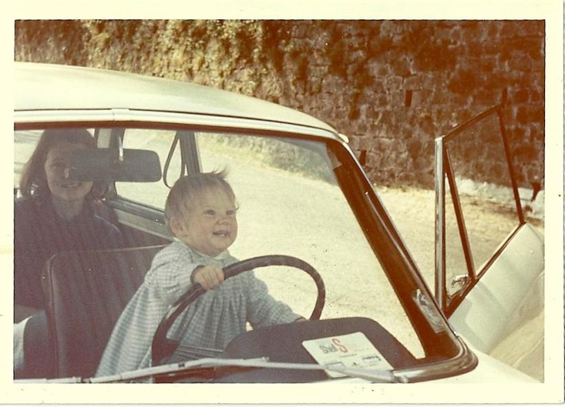 Kenna Bourke as a toddler 'driving' a car