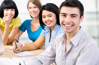 teenage_students_smiling_studying